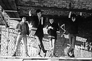 Gavin, Lee, Ian and Lorp under a bridge in Cock Lane, London. 1980s.