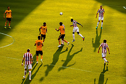 Bruno Martins Indi of Stoke City heads the ball as long shadows are cast in the evening sunlight - Mandatory by-line: Robbie Stephenson/JMP - 25/07/2018 - FOOTBALL - Bet365 Stadium - Stoke-on-Trent, England - Stoke City v Wolverhampton Wanderers - Pre-season friendly