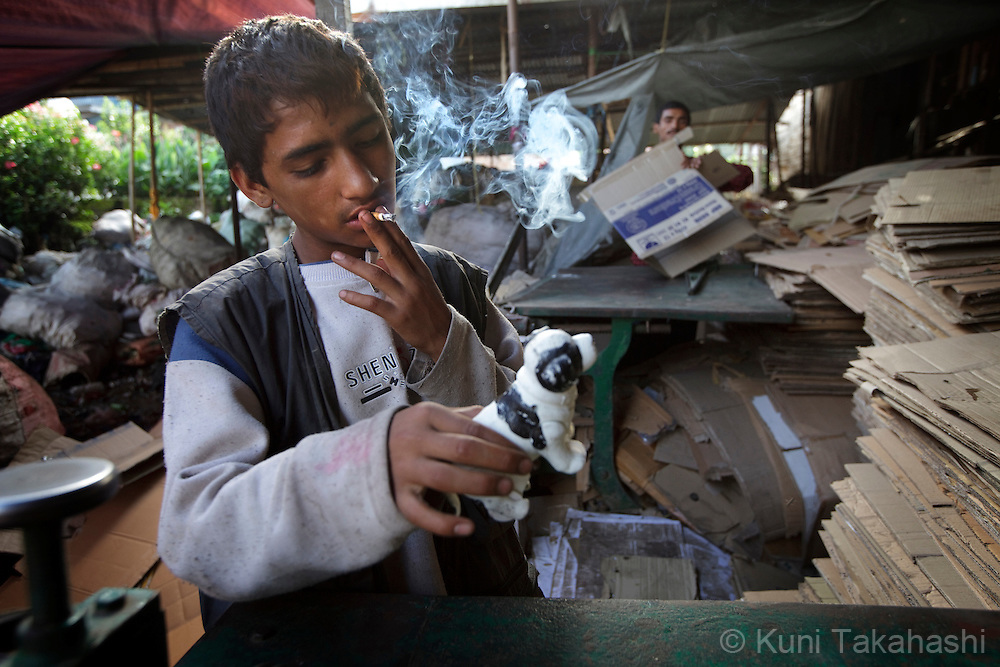 A street child plays with toy dog he found in the garbage at recycle place in Kathmandu, Nepal on Aug 21, 2012..There are estimated around 5,000 street children working and living on the streets of Nepal and the number continues to grow with roughly 300 to 500 children leaving home every year. Some do so because of abusive, alcoholic parents, maltreatment at home, and the temptation to earn more money. They often end up taking drugs, abusing alcohol, and even suffering sexual abuse by locals and foreign tourists..(Photo by Kuni Takahashi)