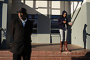 "MONTGOMERY, AL – JANUARY 25, 2016: Cabbie Michael Harris (left) waits on a new customer at the new Greyhound bus station on South Boulevard. In 2011, the downtown Montgomery Greyhound bus station was converted into a museum to honor the freedom riders, who endured a violent attack there in 1961. The replacement bus station, located four miles from downtown, is a prime business opportunity for independent cabbies like Michael Harris, who make a living serving passengers unwilling to rely on city buses. Many characterize the public bus system in Montgomery as unsafe and unreliable, so wary passengers cough up $2 per mile for trips in Mr. Harris' 2005 Lincoln Navigator, traveling across town for fast food, or sometimes as far as New York City. ""This is my life,"" Harris said. ""I love driving, and I help people out. It's just in my heart."""