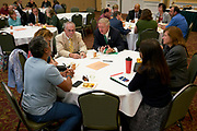 Faculty members having conversation with President Nellis at his first first Breakfast for Progress.