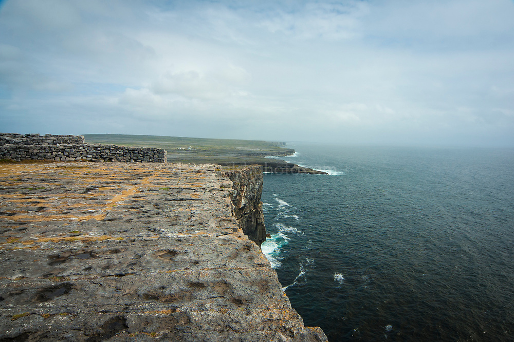 The view from the imposing Dun Aengus Stone Fort, Inishmore, the Aran Islands, off Ireland's west coast. The fort is preched on a windswept 100-metre high cliff above the Atlantic waves. Thought to date to the 2nd century BC,  it is surrounded by cheval de frise defences.