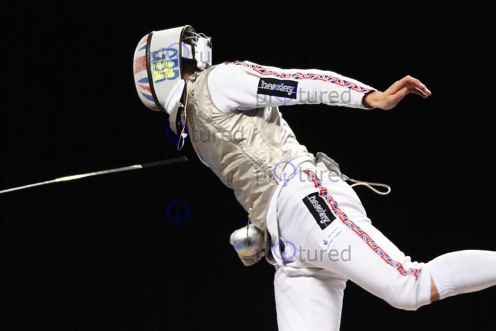 Men's Foil Fencing - Richard Kruse (GBR) vs Alexander Massialas (USA) - London 2012 Olympics test event, ExCel, London, UK. 26 November 2011. Contact: Rich@Piqtured.com +44(0)7941 079620 (Picture by Richard Goldschmidt)