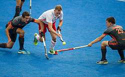 England's David Ames goes past Thierry Brinkman of The Netherlands. England v The Netherlands - Semi Final - Hockey World League Semi Final, Lee Valley Hockey and Tennis Centre, London, United Kingdom on 24 June 2017. Photo: Simon Parker