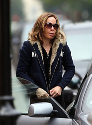 Socialite IT girl Tara Palmer-Tompkinson arriving by car at her west London home in the afternoon.  Wearing huge sunglasses, sweat pants and a jersey jacket with a hood, that she used to cover her head on spotting the photographer. London, UK. 06/09/2010<br />