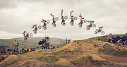 """13-frame sequence of the """"Kiss of Death"""" ( = headstand while the bike is vertical), at Farm Jam, New Zealand"""