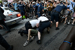 Peaceful anti-Trump protest through violent as secret service officers attempt to drive a vehicle trough  a crowd near the corner of Walnut and 19th Street, on Tuesday. (Bastiaan Slabbers for WHYY)