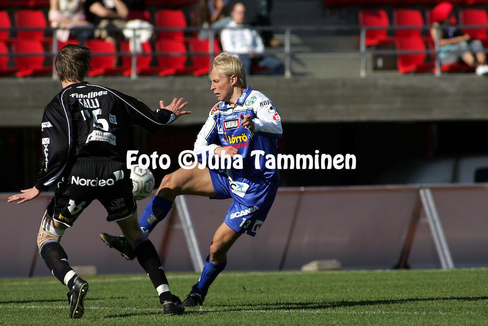 21.05.2005, Ratina, Tampere, Finland..Veikkausliiga 2005 / Finnish League 2005.Tampere United v FC Haka.Sakari Saarinen (TamU) vippaa pallon ohi Janne Sallin (Haka).©Juha Tamminen.....ARK:k