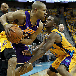 April 22, 2011; New Orleans, LA, USA; Los Angeles Lakers point guard Derek Fisher (2) is guarded by New Orleans Hornets point guard Chris Paul (3) during the third quarter in game three of the first round of the 2011 NBA playoffs at the New Orleans Arena. The Lakers defeated the Hornets 100-86.   Mandatory Credit: Derick E. Hingle