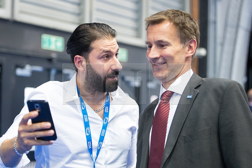 © Licensed to London News Pictures . 12/09/2017. Manchester , UK . Health Secretary JEREMY HUNT poses for a selfie with a delegate at the Health and Care Innovation Expo at Manchester Central Convention Centre . Photo credit: Joel Goodman/LNP