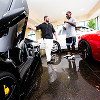 "BOCA RATON, Fla. (April 27, 2015) – MMA fighter Anthony ""Rumble"" Johnson takes a break to check out Ferraris and Lambos with salesman Jacob Ghanem at Domani Motor Cars during training for his upcoming match against Jon Jones - who was replaced by Daniel Cromier after Jones' legal issues - at Jaco Hybrid Training Center in Boca Raton, Florida. (Photo by Chip Litherland for ESPN the Magazine)"