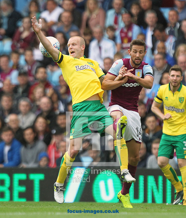 Mario Vrancic of Norwich and Conor Hourihane of Aston Villa in action during the Sky Bet Championship match at Villa Park, Birmingham<br /> Picture by Paul Chesterton/Focus Images Ltd +44 7904 640267<br /> 19/08/2017