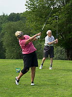 "Dale Nims and her father Phillip Roy warm up on the practice green at Lochmere Golf & Country Club in Tilton.  Nims; ""Did you get a good one Dad?""  Roy; ""Yup, pretty good"".  (Karen Bobotas/for the Laconia Daily Sun)"