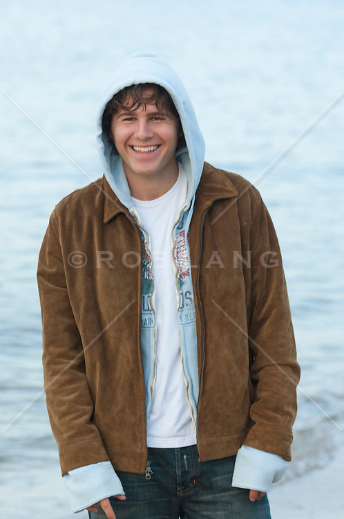 twenty something man in layered clothing smiling