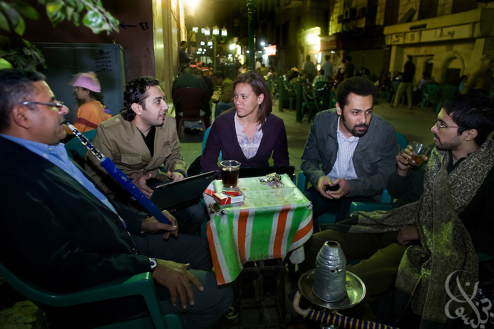 Gamal Eid, (l) executive director of the Arabic Network for Human Rights Information meets with Egyptian bloggers (from left to right) Mohamed Khaled, Shahinaz Abdel Salem, Wael Abbas, and Ahmed Garbeia  March 08, 2009 at a street cafe popular with political activists in downtown Cairo, Egypt. Eid works closely advising and representing Egyptian bloggers legally, as many have faced increased political pressure and in some cases even detention, arrest or trial in cases where their writing has angered the Egyptian government.