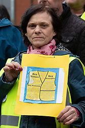 "© Licensed to London News Pictures . 09/02/2019. Manchester , UK . A woman holds up a placard during a "" Yellow Vest "" protest in Manchester City Centre . The yellow vest concept has been adopted from French demonstrators by some British groups in support of Brexit , Donald Trump and former EDL leader Stephen Yaxley-Lennon - aka Tommy Robinson . A similar demonstration in the city in January was ridiculed after protesters were kettled by police in front of a branch of Greggs the Baker . Photo credit : Joel Goodman/LNP"