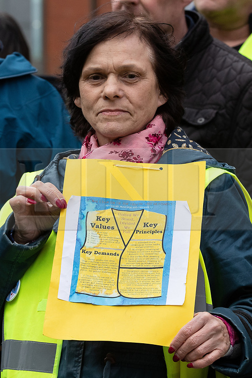 """© Licensed to London News Pictures . 09/02/2019. Manchester , UK . A woman holds up a placard during a """" Yellow Vest """" protest in Manchester City Centre . The yellow vest concept has been adopted from French demonstrators by some British groups in support of Brexit , Donald Trump and former EDL leader Stephen Yaxley-Lennon - aka Tommy Robinson . A similar demonstration in the city in January was ridiculed after protesters were kettled by police in front of a branch of Greggs the Baker . Photo credit : Joel Goodman/LNP"""