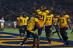 BERKELEY, CA - OCTOBER 06: Wide receiver Keenan Allen #21 of the California Golden Bears celebrates with teammates after scoring a touchdown against the UCLA Bruins during the second quarter at California Memorial Stadium on October 6, 2012 in Berkeley, California. The California Golden Bears defeated the UCLA Bruins 43-17. (Photo by Jason O. Watson/Getty Images) *** Local Caption *** Keenan Allen
