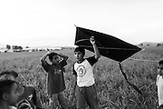 17 April 2016, Idomeni Greece - Children playing with a kite at an improvvised camp at the Greek-Macedonian border.