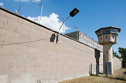 Guard tower and perimeter wall at former East German state secret security police or STASI prison at Hohenschönhausen in Berlin Germany