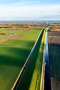 Nederland, Flevoland, 28-02-2016; Knardijk gezien naar Oostvaardersplassen.<br /> De dijk vormt de grens tussen Oostelijk en Zuidelijk Flevoland en voorkomt dat bij een dijkdoorbraak de gehele Flevopolder overstroomt.<br /> Knar dike forms the border between Eastern and Southern Flevoland and prevents in case of breach of the outer dikes of the polder, that the entire Flevo polder will be flooded.<br /> <br /> luchtfoto (toeslag op standard tarieven);<br /> aerial photo (additional fee required);<br /> copyright foto/photo Siebe Swart