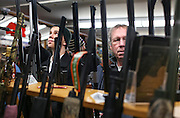 Racks of guns frame media and local attendees as they wait for Republican presidential candidate Gov. John Kasich, R-Ohio, to arrive at the Walt Morse Sporting Good Store in Hillsboro,  N.H. Tuesday, Jan. 19, 2016.  CREDIT: Cheryl Senter for The New York Times