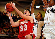 5 MARCH 2011 -- NORMANDY, Mo --  Giovanni Ferrara (33) of Chaminade College Prep drives to the basket past McCluer North High School's Keaton Turner (34) and BJ Young (1) during the MSHSAA Class 5 boys basketball quarterfinals at Mark Twain Hall on the University of Missouri - St. Louis campus in Normandy, Mo. Saturday, March 5, 2011. The Stars upset the Red Devils 57-56 to advance to MSHSAA semifinals. Image © copyright 2011 Sid Hastings.