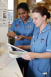 Staff nurses in clinical room checking intravenous antibiotic drugs,