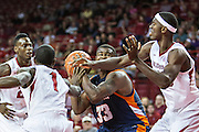 FAYETTEVILLE, AR - DECEMBER 19:  Myles Taylor #33 of the UT Martin Skyhawks is defended by Mardracus Wade #1 and Bobby Portis #10 of the Arkansas Razorbacks at Bud Walton Arena on December 19, 2013 in Fayetteville, Arkansas.  The Razorbacks defeated the Skyhawks 102-56.  (Photo by Wesley Hitt/Getty Images) *** Local Caption *** Myles Taylor; Bobby Portis; Mardracus Wade