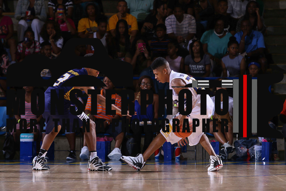Yazz The Great (23) dribbles the ball as Diggy Simmons (3) defends in the first half of The 2015 Duffy's Hope Celebrity Basketball Game Saturday, August 01, 2015, at The Bob Carpenter Sports Convocation Center, in Newark, DEL.    <br /> <br /> Proceeds will benefit The Non-Profit Organization Duffy's Hope Youth Programming.