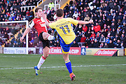 Woking midfielder Charlie Carter (12) puts in a high tackle on Accrington Stanley midfielder Sean McConville (11), and is then sent off, during the The FA Cup match between Woking and Accrington Stanley at the Kingfield Stadium, Woking, United Kingdom on 4 December 2016. Photo by David Charbit.