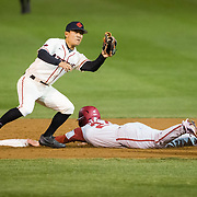 24 February 2018: The San Diego State Aztec baseball team competes in day two of the Tony Gwynn legacy tournament against #4 Arkansas. San Diego State Aztecs infielder Jacob Maekawa (3) attempts to tag out Arkansas Razorbacks Dominic Fletcher (24) while he steals second base in the sixth inning. The Aztecs dropped a close game to the Razorbacks 4-2. <br /> More game action at sdsuaztecphotos.com