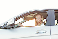 Portrait of beautiful woman driving car