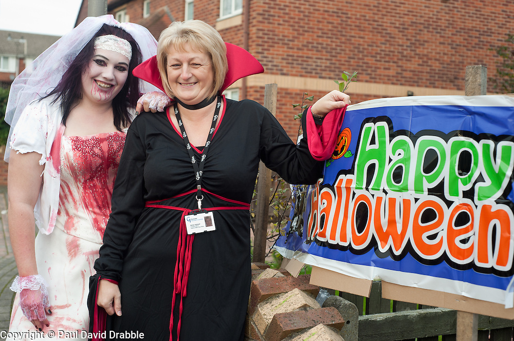 Guinness Northern Counties Housing Associations Godley Street  scheme hold a Halloween street party. Becki Mallinder with Guinness Northern Counties Housing Officer Shirley Adshead...30 October 2010 .Images © Paul David Drabble