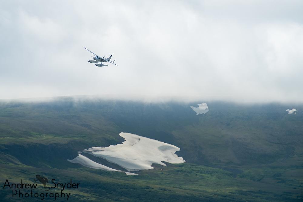 A float plane flies over the Alaskan wilderness - Katmai, Alaska