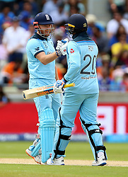 England's Jason Roy (right) with Jonny Bairstow, after reaching fifty runs, during the ICC Cricket World Cup group stage match at Edgbaston, Birmingham.