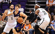 Nov 15, 2013; Phoenix, AZ, USA; Phoenix Suns guard Goran Dragic (1) handles the ball against the Brooklyn Nets guard Deron Williams (8) and forward Paul Pierce (34) in the first half at US Airways Center. Mandatory Credit: Jennifer Stewart-USA TODAY Sports