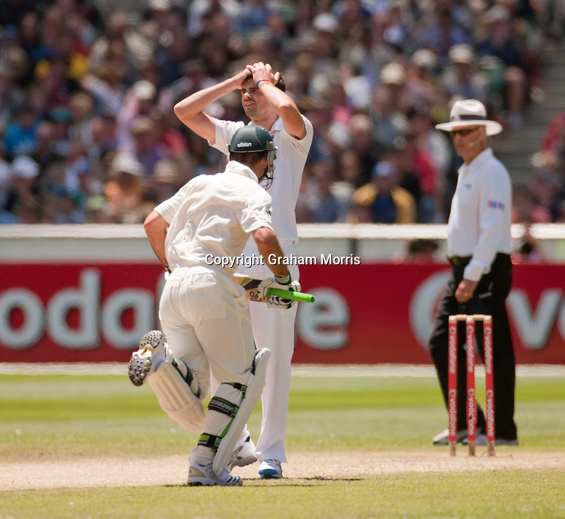 James Anderson as Ricky Ponting runs off his bowling during the fourth Ashes test match between Australia and England at the MCG in Melbourne, Australia. Photo: Graham Morris (Tel: +44(0)20 8969 4192 Email: sales@cricketpix.com) 28/12/10