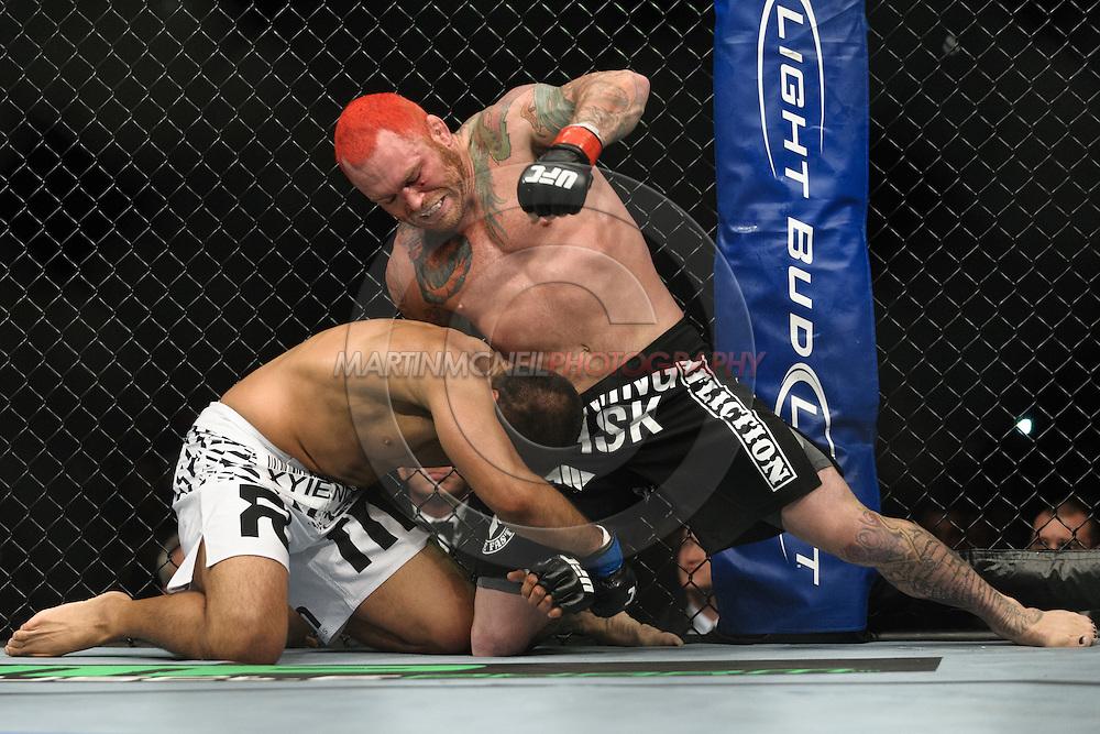 "BIRMINGHAM, ENGLAND, NOVEMBER 5, 2012: Chris Leben (top) tries to fend off Mark Munoz during ""UFC 138: Munoz vs. Leben"" inside the National Indoor Arena in Birmingham, United Kingdom"
