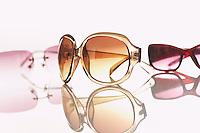 Three pairs of sunglasses studio shot