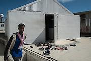 Malta, Hal Far. Open Center. Scarpe accumulte fuori ad una piccola moschea all'interno del centro durante una preghiera