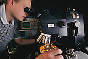 Micro Technology: Micromechanics at the University of California, Berkeley. In the microelectromechanical system (MEMS) lab at Cory Hall a researcher at a micromanipulator probe station testing a micro machined chip. Model Released [2000]