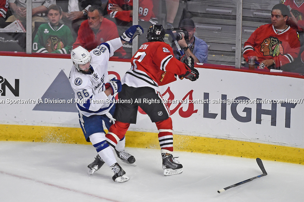 08 June 2015: Tampa Bay Lightning Right Wing Nikita Kucherov (86) [8989] battles Chicago Blackhawks Defenseman Johnny Oduya (27) [2297] while playing in game 3 of the Stanley Cup Final at the United Center, Chicago, Il