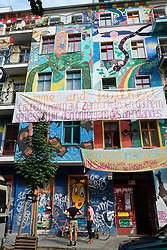 Colourful art painted on apartment buildings in bohemian Friedrichshain district of Berlin Germany