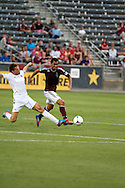 July 24th, 2012:  Colorado Rapids forward Kamani Hill (13) tries to set up a shot in the Rapids 2-1 win over Swansea City AFC in a international friendly soccer match in Denver, CO.
