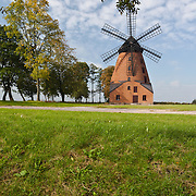 Old wind mill of brick in Poland photo Piotr Gesicki