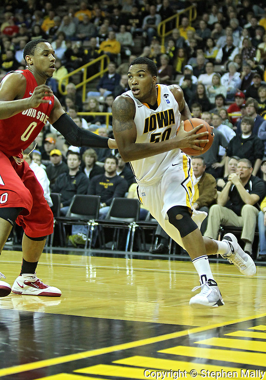 January 04 2010: Iowa Hawkeyes forward Jarryd Cole (50) drives around Ohio State Buckeyes forward Jared Sullinger (0) during the first half of an NCAA college basketball game at Carver-Hawkeye Arena in Iowa City, Iowa on January 04, 2010. Ohio State defeated Iowa 73-68.