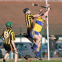 """Ballyea's Tony Kelly & Sixmilbridge's Eoin Hogan in an aerial battle for possession during the Minor """"A"""" Hurling Final at Clarecastle. - Photograph by Flann Howard"""