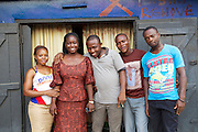 Joy (second from left) with her staff outside their restaurant in Nigeria.<br />