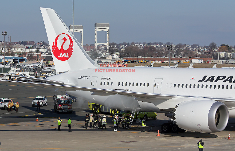 (Boston,MA-01/07/13)- Massport and Boston firefighters work to douse a fire in a Japan Airlines Boeing 787 Dreamliner's cargo hold today, January 7, 2013. photo by Mark Garfinkel.